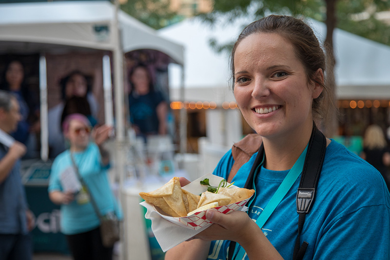 Craft Lake City Social Media Coordinator, Mary Elizabeth Hammond took an empanada break after visiting the Argentine's Best booth.