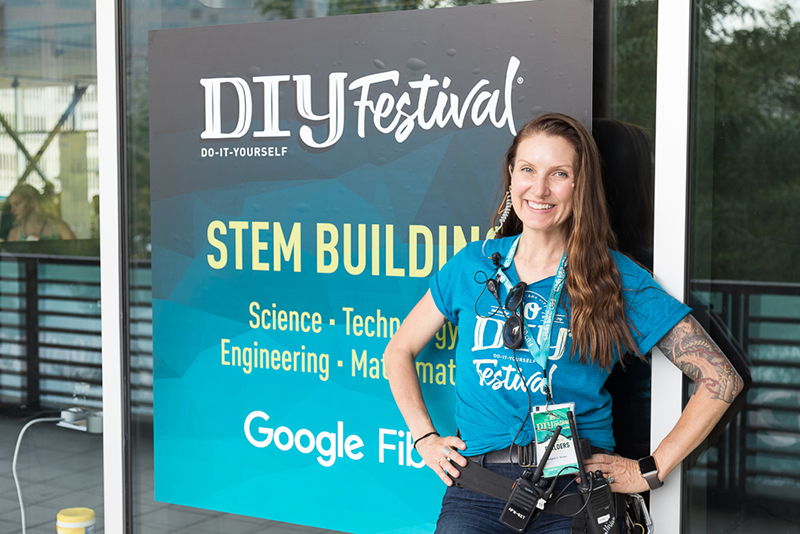 From high up on the Google Fiber STEM building's balcony, Craft Lake City Executive Director Angela Brown is proud to see the Tenth Annual DIY Festival wind down on Sunday evening, August 12, 2018.
