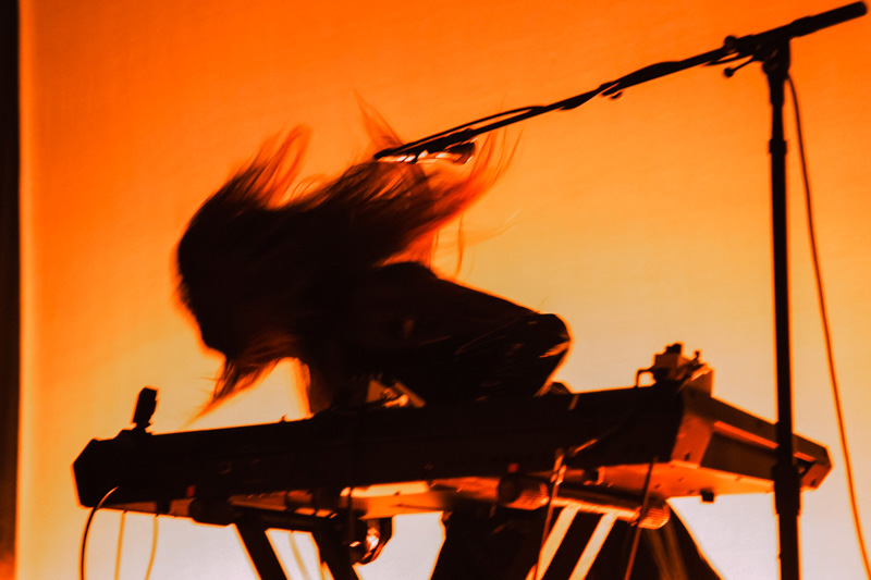 Legrand's long, unkempt hair is a staple for Beach House performances.