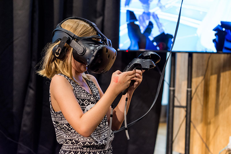 Young girl experiences Virtual Reality.