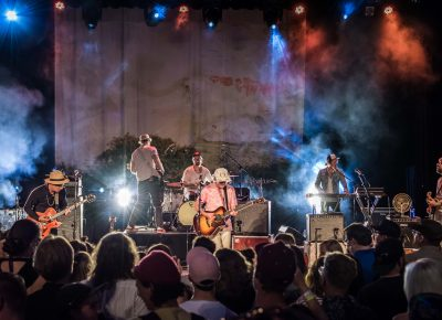 Broken Social Scene rocks out with lightning crackling in the distance.