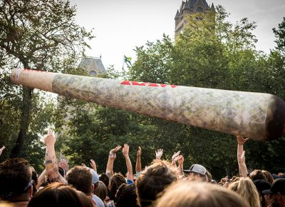 A giant joint bounces above the crowd.