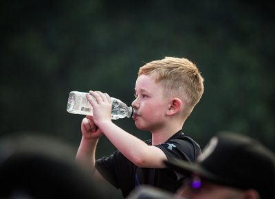 A young fan stays hydrated.