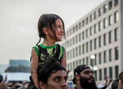 A young fan enjoying herself.