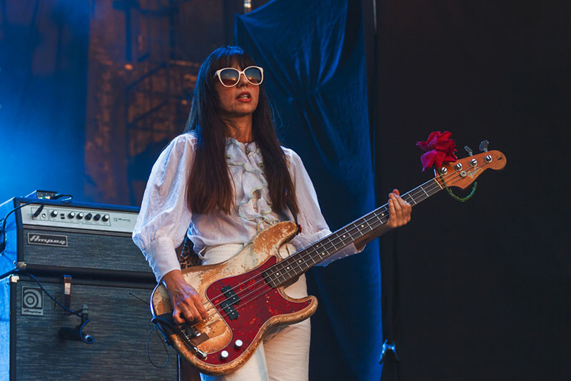Paz Lenchantin keeps rockin the shades as the sunset blinds the stage.