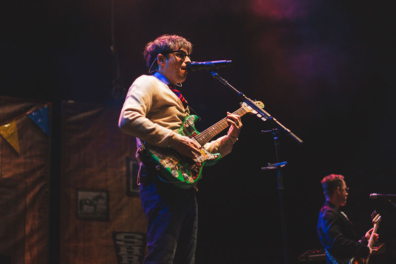 Weezer frontman Rivers Cuomo opens the night with a groundbreaking rendition of Buddy Holly.
