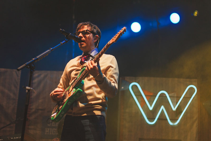 Rivers Cuomo is always dressed to the nines while performing with Weezer.