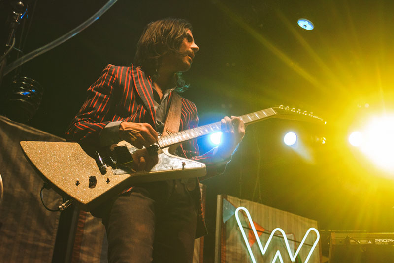 "Brian Bell looks over to Cuomo while performing ""Beverly Hills"" with Weezer."