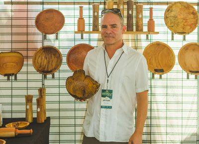 Alan Peck displays his woodcrafter wares.