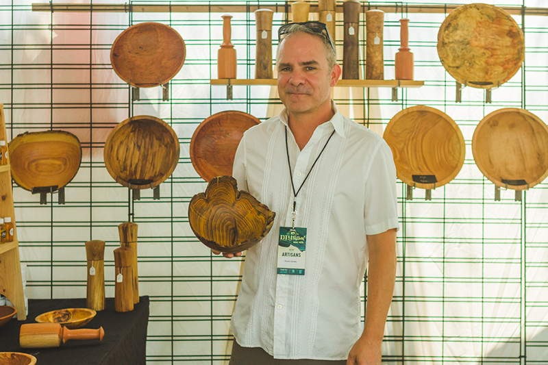 Alan Peck displays his woodcrafter wares.