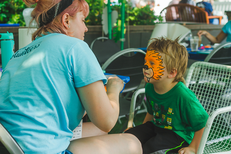 Our volunteer face painters take their work very seriously.