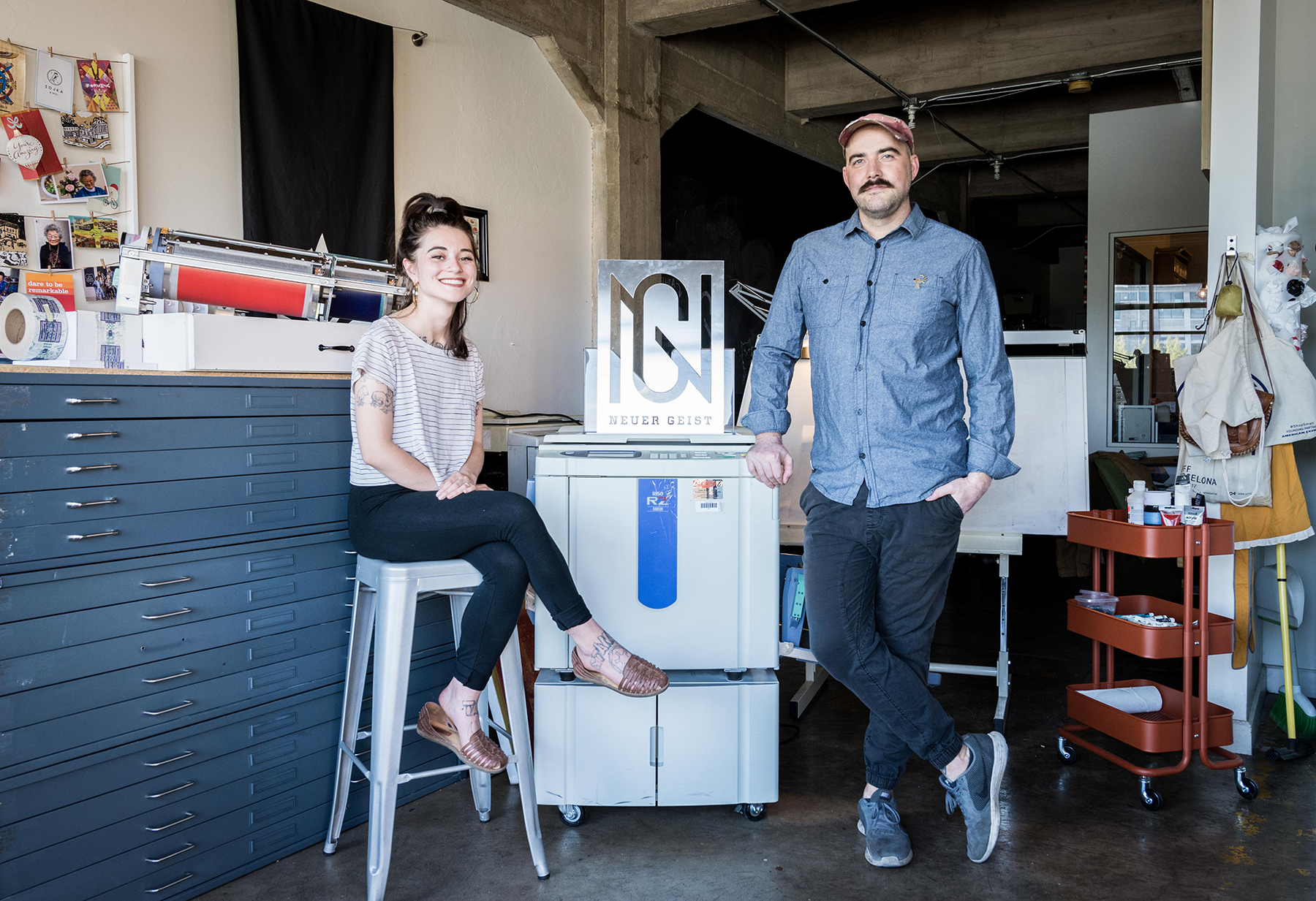 (L–R) Brighton Ballard and Derek Ballard flex their design and branding prowess with their risograph machines.