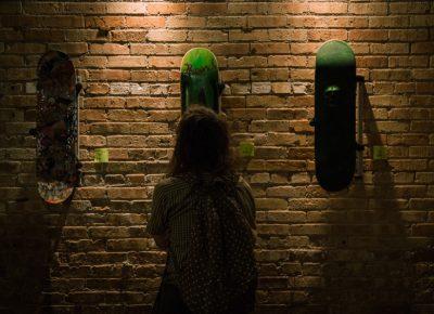 A guest admires the skate decks.