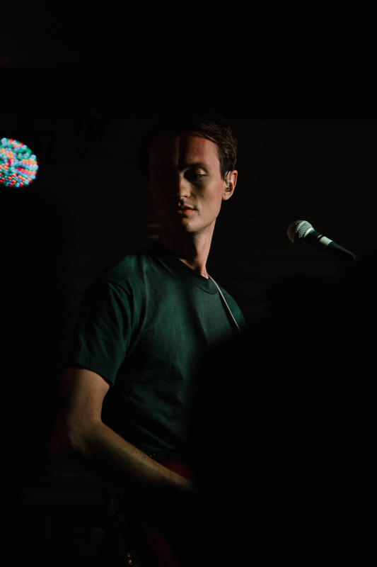 Ought frontman Tim Darcy kicking off the band's first song of the night.