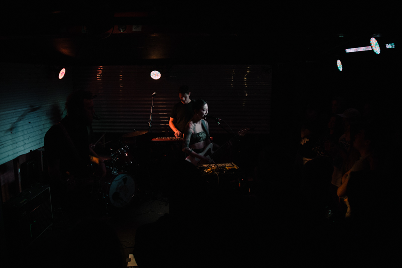 Zauner and her band occupying the dark Kilby stage.
