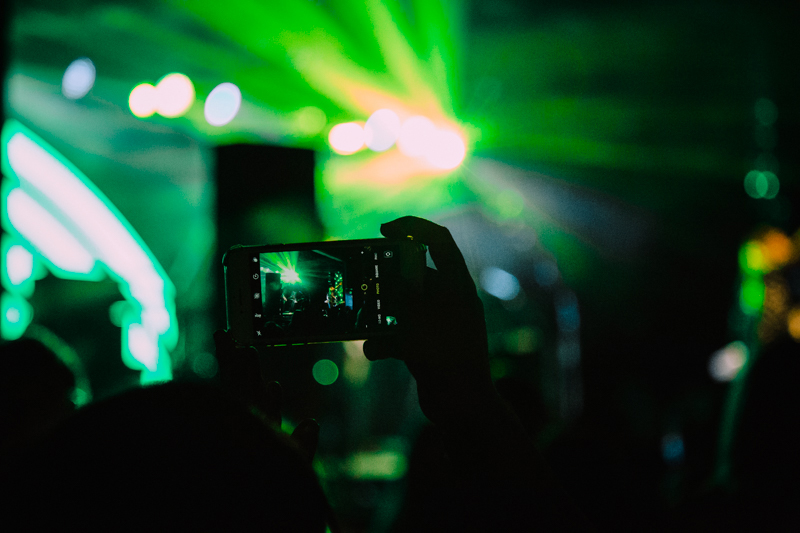 A fan taking a photo during the show.