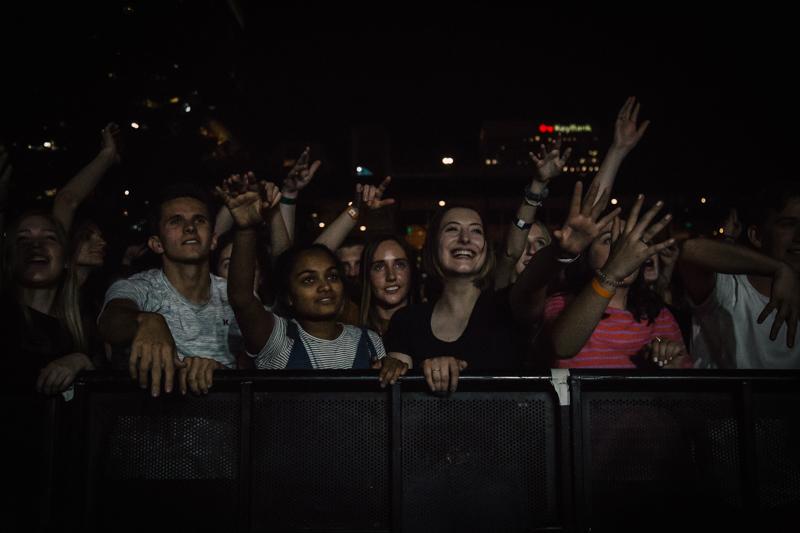 A mesmerized crowd singing back lyrics to the band.