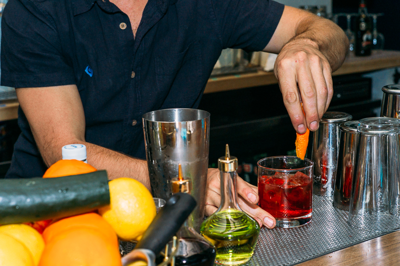 Jacob Hall puts the finishing touches on a Sazerac cocktail. Photo: @clancycoop