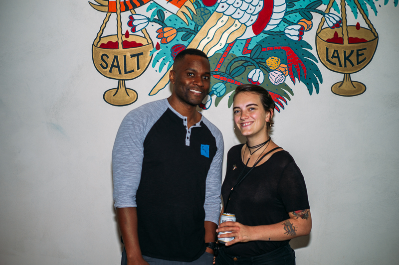 (L-R) Alibi employees Jay Whittaker and Kenzi Anderson were happy to pose in front of Alibi's distinctive mural. Photo: @clancycoop
