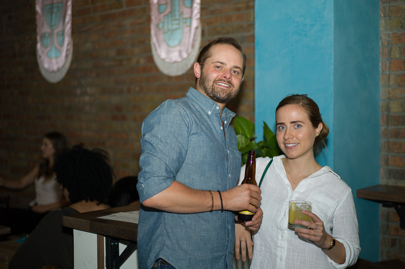 Cameron Hauck and Amy Garcia posted up at the bar, adjacent the large open area for standing. (L-R) Photo: @clancycoop