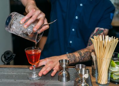 Jacob Hall pours a Sazerac, a traditional cocktail based on cognac. Photo: @clancycoop