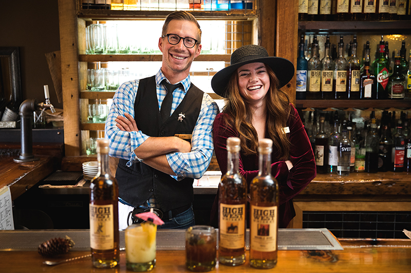 Bartenders on staff at the P.C. Saloon get together a few times a year to craft new cocktails and work on creations that visitors will fall in love with. (L–R) David Perkins and Jane Perkins. Photo: LmSorenson.net