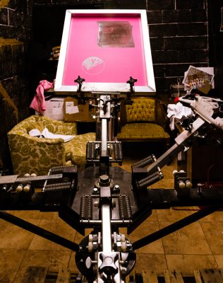 Goldblood Collective's trusty screen-printing machine. Photo by: Jennifer Thayn