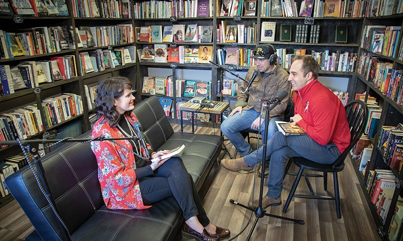 (Center–Right) Brandon Long and Kase Johnstun interview Amanda Luzzader (Left) in Booked on 25th in Ogden for the LITerally Podcast. Photo: John Barkiple