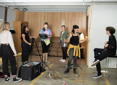 """(L–R) Adriene Klein, Deana Jarquin, Olivia Von Hagen, Sage Nelsen, Film Mentor Paige Sparks and Jonah Janeway on set in Spy Hop's """"Film Apprenticeship Program."""" Photo by John Barkiple"""
