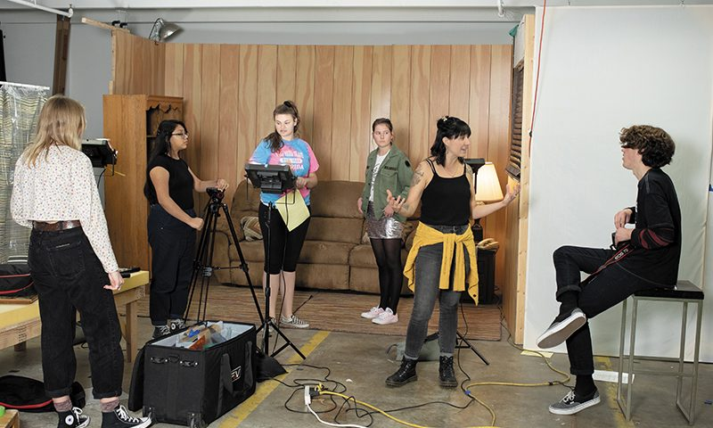 "(L–R) Adriene Klein, Deana Jarquin, Olivia Von Hagen, Sage Nelsen, Film Mentor Paige Sparks and Jonah Janeway on set in Spy Hop's ""Film Apprenticeship Program."" Photo by John Barkiple"