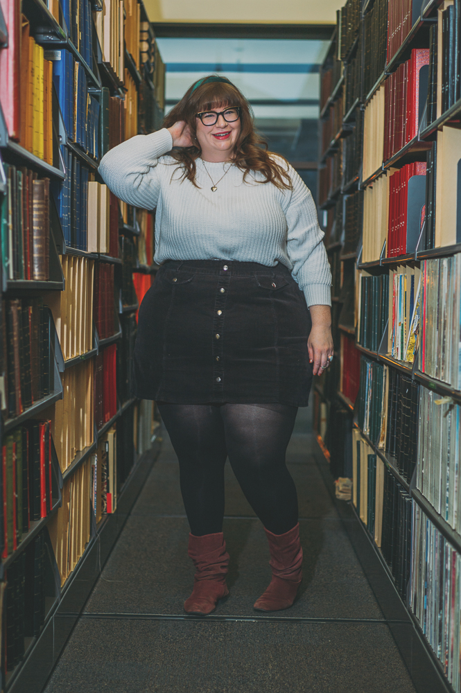 """""""I love books. Mainly I love zines, so I've been reading and collecting zines since I was 15. I got really into Riot Grrrl culture,"""" says Baker. """"I lived in Baltimore, Maryland and D.C. when I was younger so big scene out there for zines. When I came to the main library I got the opportunity to start working with the zine collection and I am chair of the Alt Press Fest committee, which runs the Alt Press Fest that we have every year and we're on our tenth year."""" Photo: @clancycoop"""