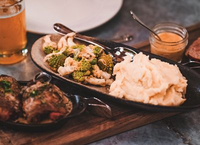 The courses for the Supper Club Series change weekly. This week featured raw vegetables, a smoked-chicken forestiere, mashed potatoes and white-wine-and-mushroom sauce served next to an elk meatloaf. Photo: Talyn Sherer