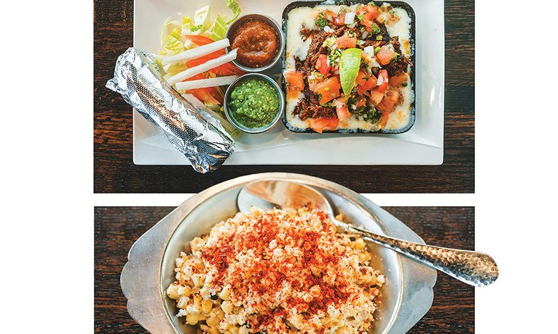 The Barbacoa Tacos (top) come in a skillet embedded in Oaxaca cheese and topped with Pico de Gallo, while the Elotes de la Calle (bottom) are grilled in a lime aoli and topped with cotija cheese. Photo: Talyn Sherer