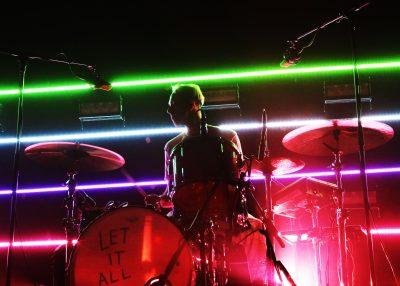 Ryan Winnen on drums and some sick lighting behind him. Photo: @Lmsorenson Photography