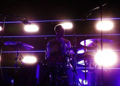 Ryan Winnen drumming in the dark. Photo: @Lmsorenson Photography