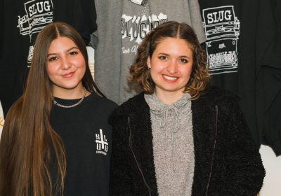 (L-R) Madi and Hilary hold down the SLUG Swag booth in Rye.