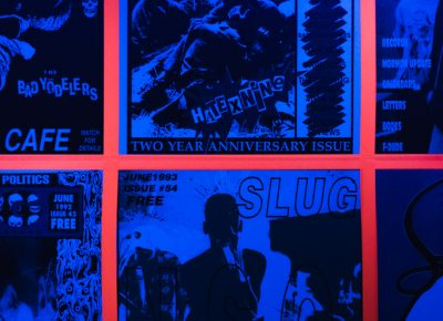 SLUG cover wallpaper is coming to a blacklight room near you!