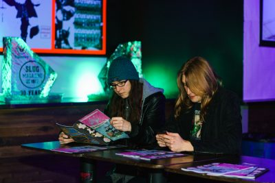 While waiting for the bands to go on, some SLUG Mag aficionado's enjoy our latest issue.