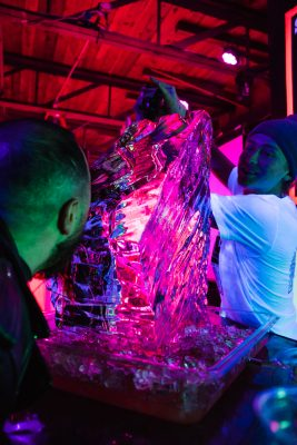 An unspecified senior editor takes his ice luge shot the more traditional way.