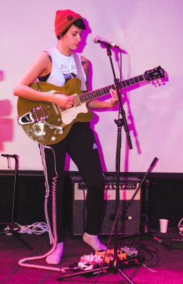 Nora Price of Durian Durian heads up the electric guitar mid performance.
