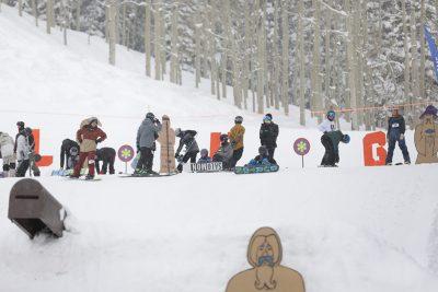 Snowboarders preparing for their next tricks.