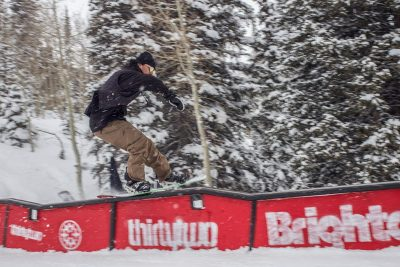 Tail press on a wave rail by Jerome.over the roof.