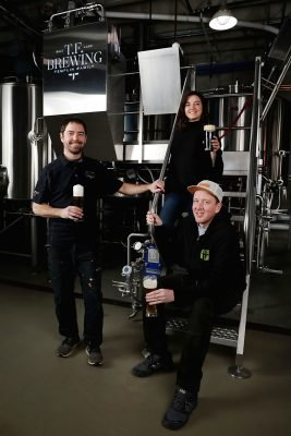 (L–R) Co-owner/brewer Kevin Templin, Brittany Watts and Jaron Anderson band together for the family feel of T.F. Brewing and its German-style lagers.