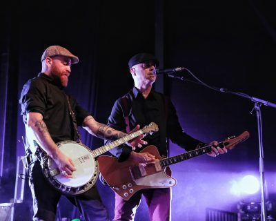 Bob Schmidt and Dennis Casey playing banjo annd guitar while providing back up vocals. Photo: @Lmsorenson