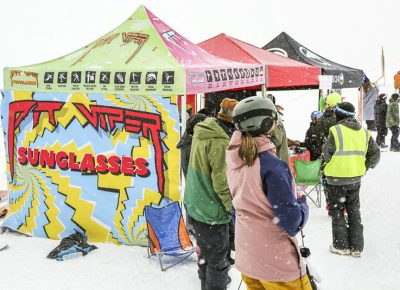 People gather to the sponsor booths despite the snowy weather.