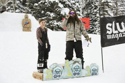 2nd place winner Jaida Davis for women's 17 & under snowboard steps up to the podium.
