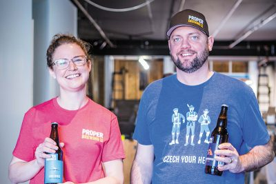 (L–R) Proper Brewing Co. Marketing Director Eleanor Lewis and Co-Owner Andrew Tendick are hard at work preparing Craft by Proper, a Utah-only beer bar in the heart of Sugar House.