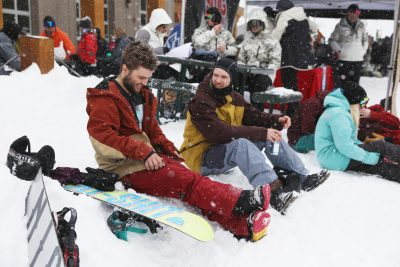Friends enjoy their day in the snow.