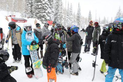 Contestants mill around between events.