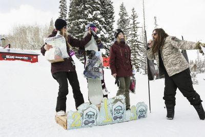 Winners of the woman's open snow show gratitude. 1st place Gwynnie Park, 2nd place.